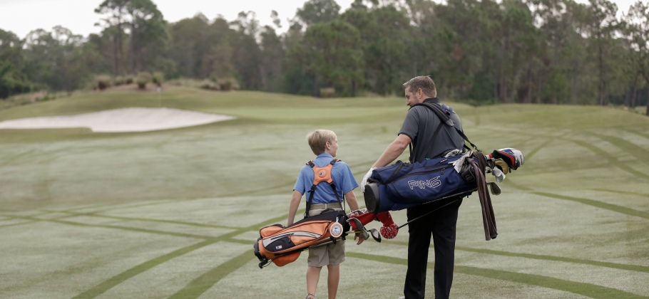 Father and son walk a 9 hole golf round